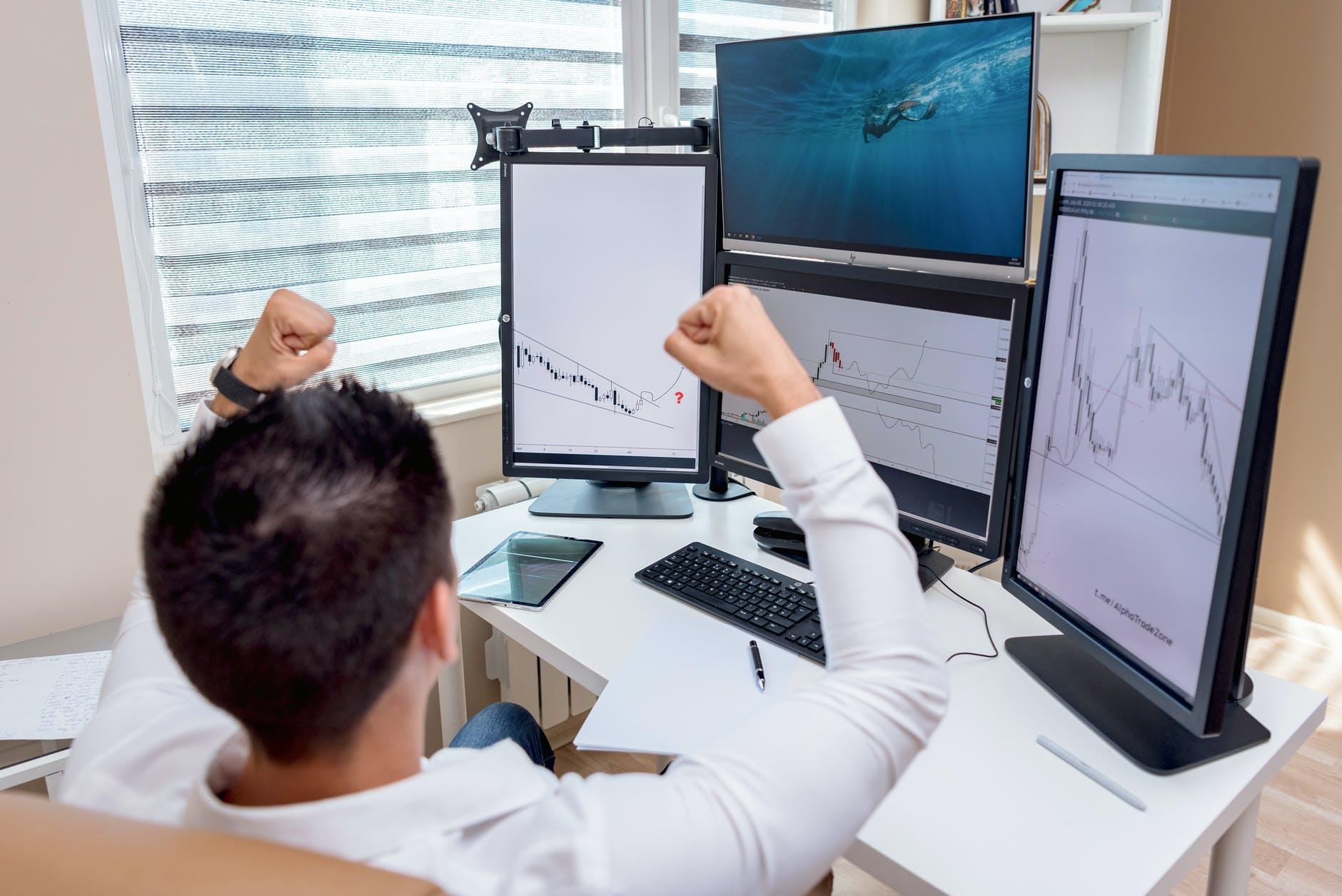 man woman desk laptop